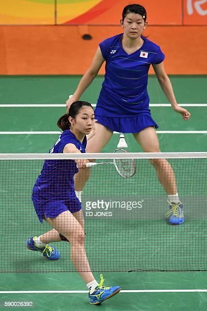 Japan's Misaki Matsutomo and Japan's Ayaka Takahashi react after winning against South Korea's Jung Kyung Eun and South Korea's Shin Seung Chan...