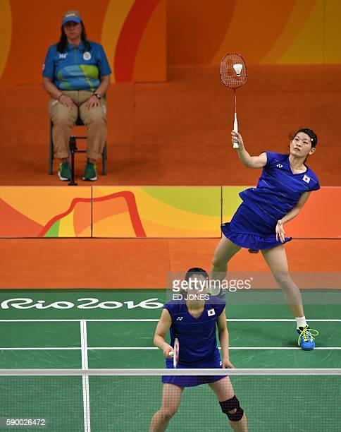 Japan's Misaki Matsutomo and Japan's Ayaka Takahashi return to South Korea's Jung Kyung Eun and South Korea's Shin Seung Chan during their women's...