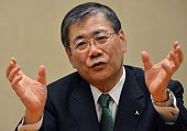 Japan's Mitsubishi Heavy Industries president Shunichi Miyanaga speaks before press at the company's headquarters in Tokyo on December 18 2015 The...