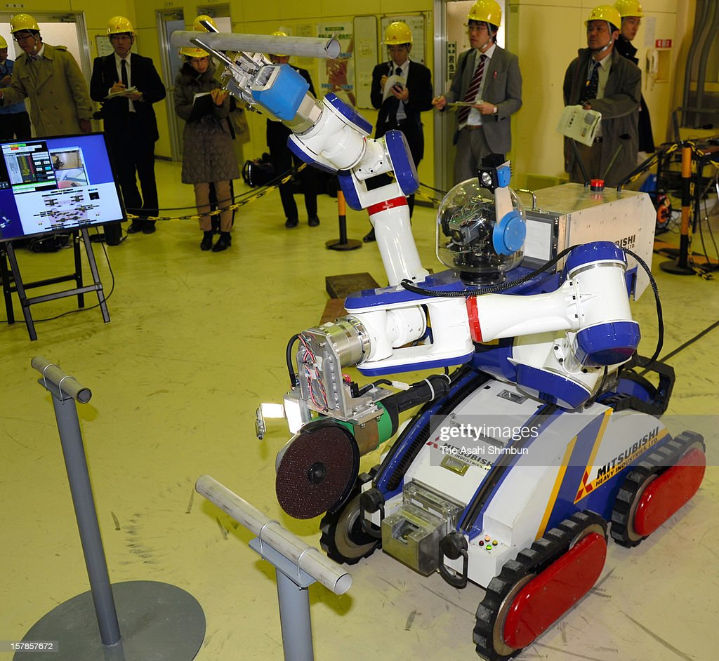 Japan's Mitsubishi Heavy Industries unveils its latest remote controlled inspection robot 'MHI-MEISTeR' designed to work in radioactive areas at thier Kobe Shipyard & Machinery Works on December 6, 2012 in Kobe, Hyogo, Japan.