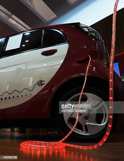 A Japan's Mitsubishi Innovative Electric Vehicle is displayed at the Parque dos Atletas area where countries shows projects for a green future as...