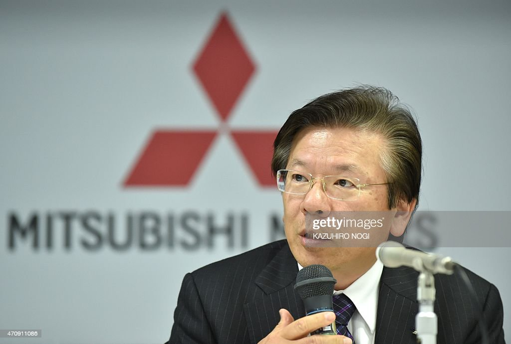 Japan's Mitsubishi Motors Corporation President and Chief Operating Officer Tetsuro Aikawa answers questions during a press conference to announce...