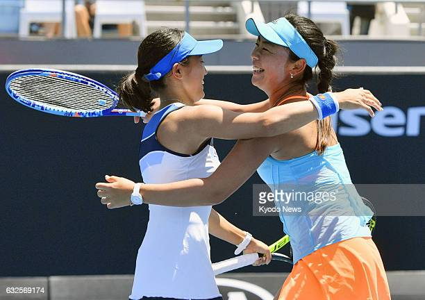 Japan's Miyu Kato and Eri Hozumi celebrate after winning their doubles quarterfinal match of the Australian Open in Melbourne on Jan 24 2017 They...