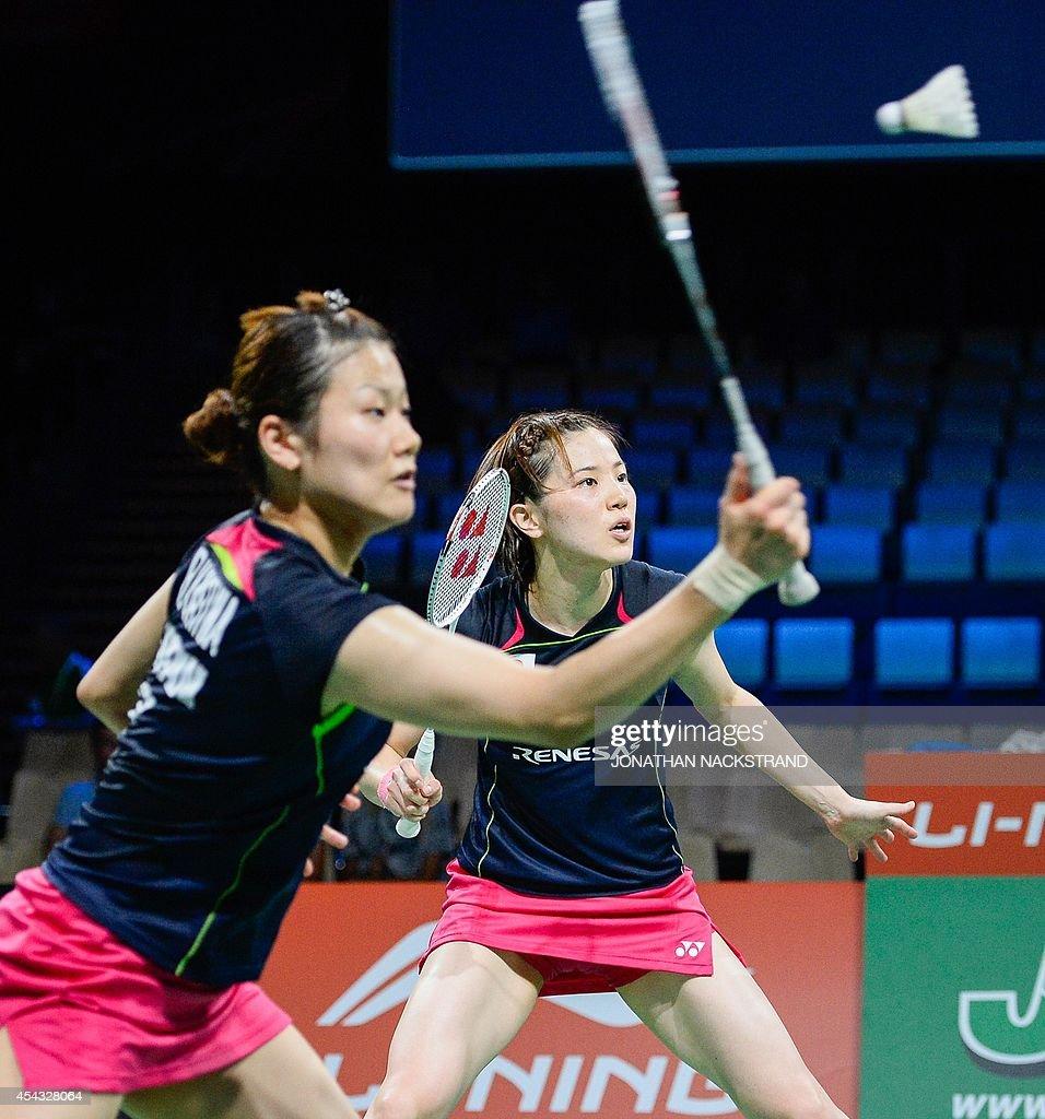 Japan s Miyuki Maeda R and Reika Kakiiwa pete against