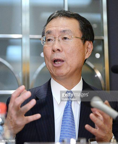 Japan's Mizuho Bank President Nobuhide Hayashi meets with reporters in Beijing on Dec 7 announcing that his bank is considering expanding its...