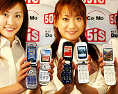Japan's mobile communication giant NTT DoCoMo unveils the new 'mova 505iS' series mobile phone handsets produced by Sharp Sony Panasonic Mitsubishi...