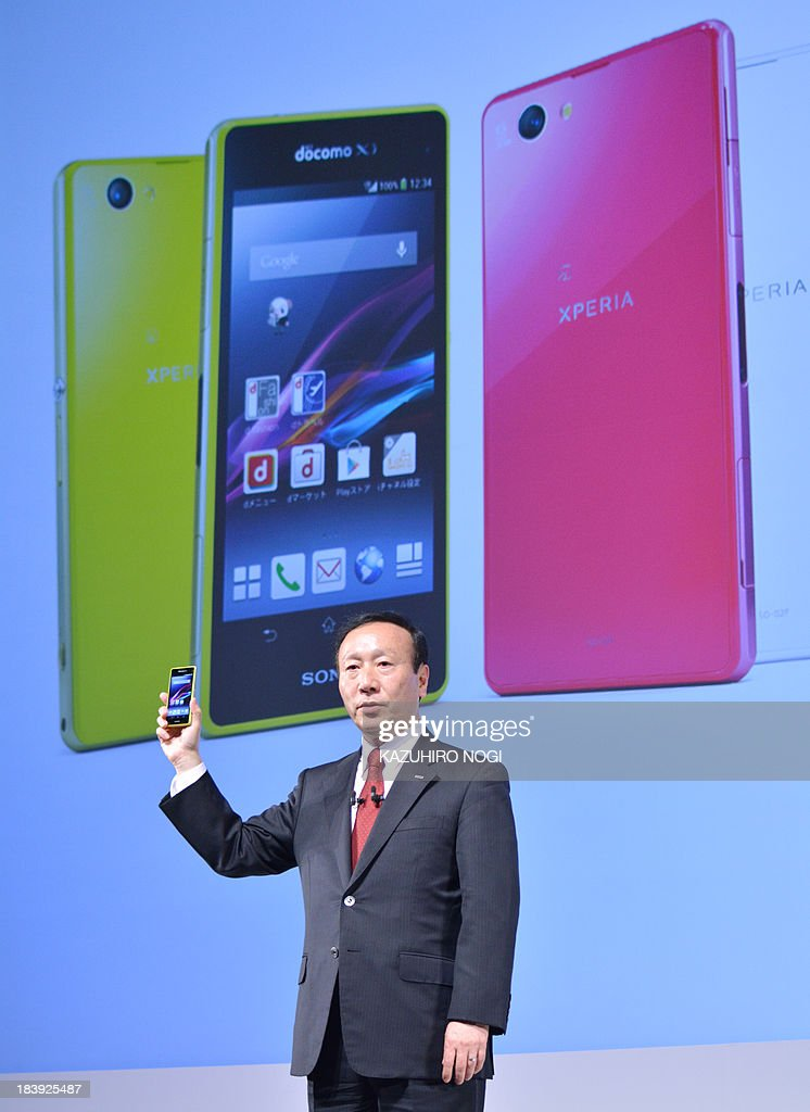 Japan's mobile phone carrier NTT docomo president Kaoru Kato introduces a new smartphone 'XPERIA Z1f SO-02F' produced by SONY during a press briefing to announce the company's 2013-2014 winter spring models in Tokyo on October 10, 2013. NTT docomo announced the 2013-2014 winter spring model, providing a total of 16 models. It will be released sequentially from October 11.