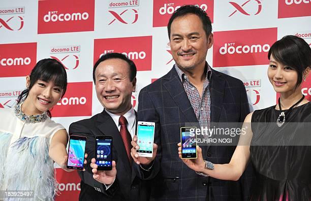 Japan's mobile phone carrier NTT docomo president Kaoru Kato actress Satomi Ishihara actor Ken Watanabe and actress Maki Horikita pose with the...