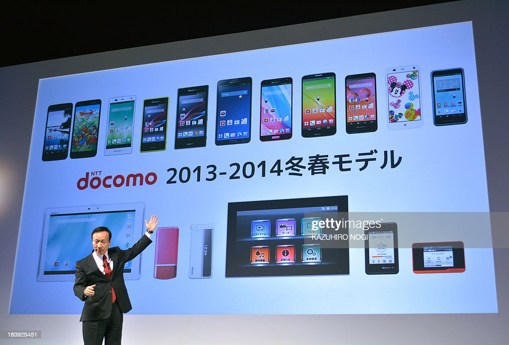 Japan's mobile phone carrier NTT docomo president Kaoru Kato speaks during a press briefing to announce the company's 20132014 winter spring models...