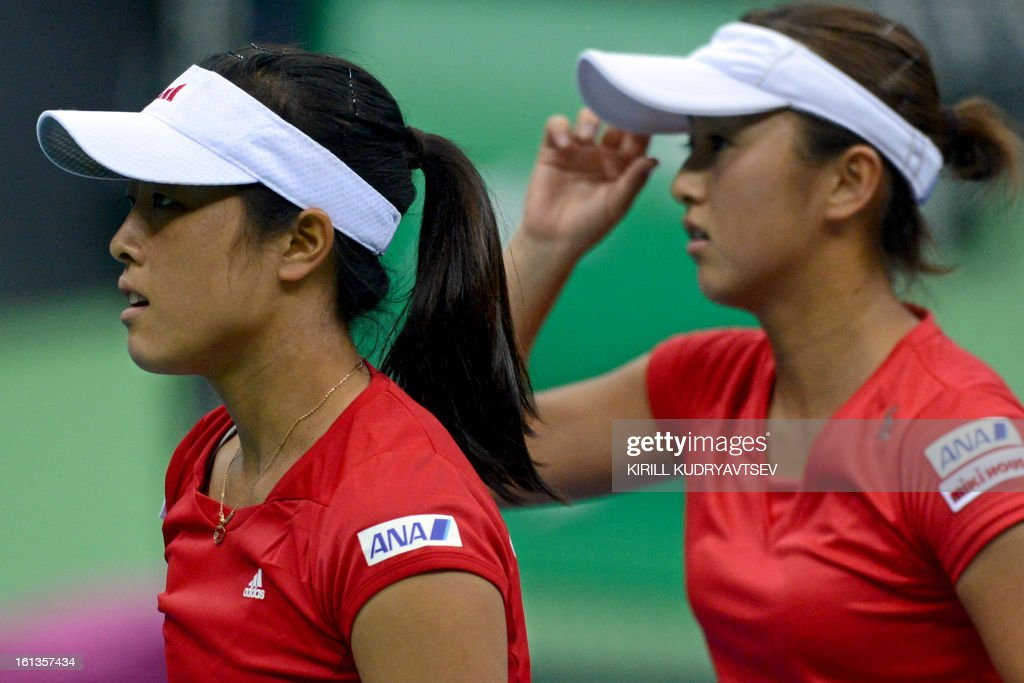 Japan's Morita Ayumi (L) and Misaki Doi react after losing a point against Russia's Elena Vesnina and Ekaterina Makarova during the International Tennis Federation Fed Cup quarterfinal match between Russia and Japan in Moscow on February 10, 2013. Russia won 3-2.
