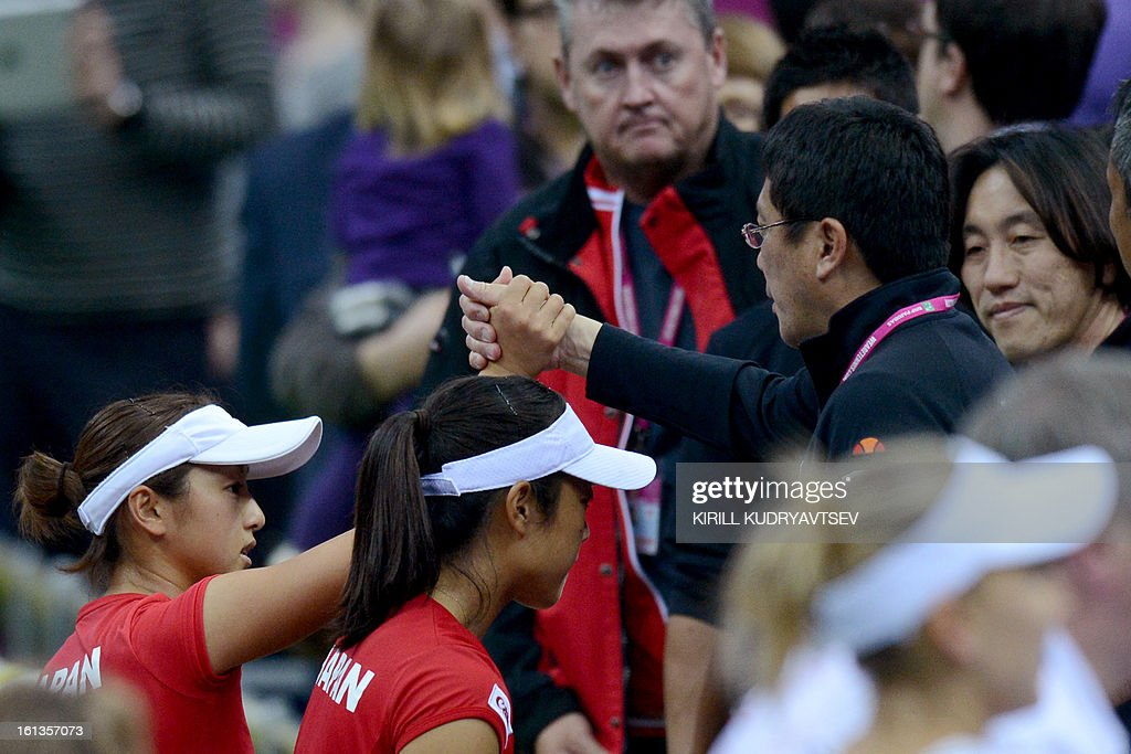 Japan's Morita Ayumi (2ndL) and Misaki Doi (1stL) react after thier match against Russia's Elena Vesnina and Ekaterina Makarova during the International Tennis Federation Fed Cup quarterfinal match between Russia and Japan in Moscow on February 10, 2013. Russia won 3-2.