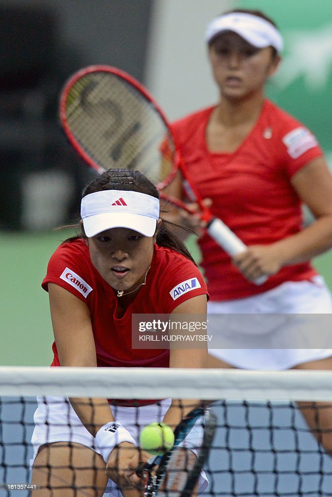 Japan's Morita Ayumi (L) and Misaki Doi return a ball to Russia's Elena Vesnina and Ekaterina Makarova during the International Tennis Federation Fed Cup quarterfinal match between Russia and Japan in Moscow on February 10, 2013. Russia won 3-2.