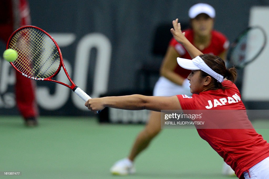 Japan's Morita Ayumi and Misaki Doi (in front) return a ball to Russia's Elena Vesnina and Ekaterina Makarova during the International Tennis Federation Fed Cup quarterfinal match between Russia and Japan in Moscow on February 10, 2013. Russia won 3-2.