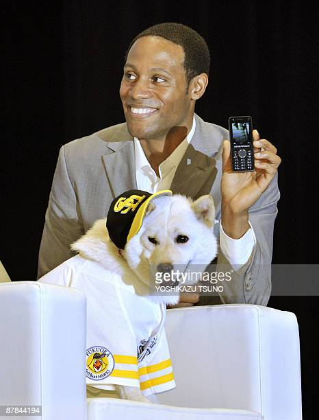 Japan's most famous commercial TV character dog 'Kai' wears the baseball uniform of professional baseball team the Softbank Hawks as US actor Dante...