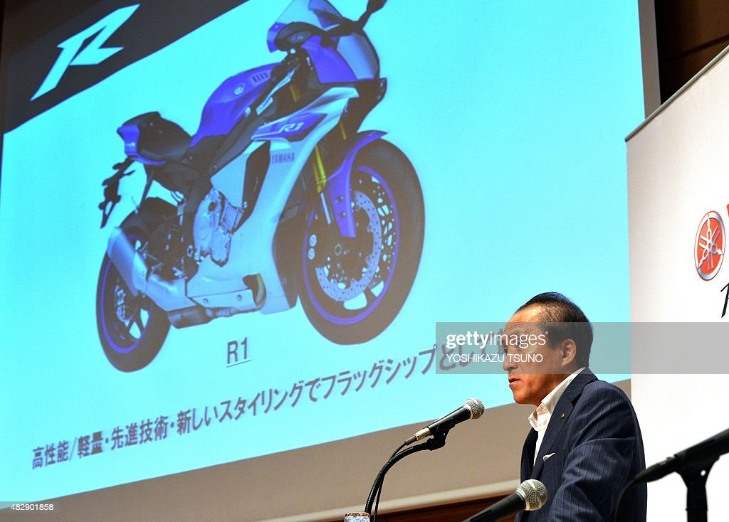 Japan's motorcycle giant Yamaha Motor president Hiroyuki Yanagi announces the first half financial result in Tokyo on August 4, 2015, while Yamaha's flagship motorcycle YZF-R1 is seen his background. Yamaha's net sales increased 8.6 percent to 821 billion yen (6.62 billion USD) and operating income increased 42 percent to 69.7 billion yen (562 million USD) thanks to sales of motorcycles and marine products. AFP PHOTO / Yoshikazu TSUNO