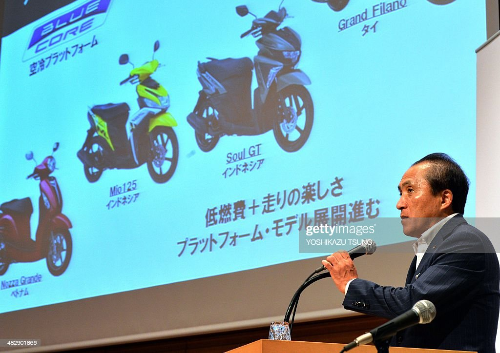 Japan's motorcycle giant Yamaha Motor president Hiroyuki Yanagi announces the first half financial result in Tokyo on August 4, 2015, while Yamaha's Asian market models are seen his background. Yamaha's net sales increased 8.6 percent to 821 billion yen (6.62 billion USD) and operating income increased 42 percent to 69.7 billion yen (562 million USD) thanks to sales of motorcycles and marine products. AFP PHOTO / Yoshikazu TSUNO