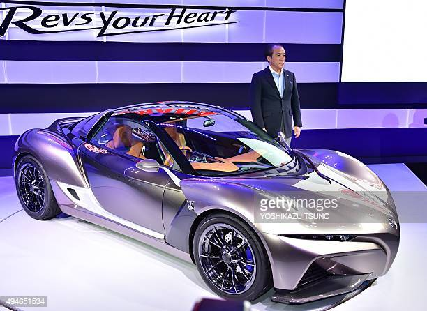 Japan's motorcycle maker Yamaha Motor president Hiroyuki Yanagi Introduces the new twoseater concept sports car 'Sports Ride Concept' during a press...