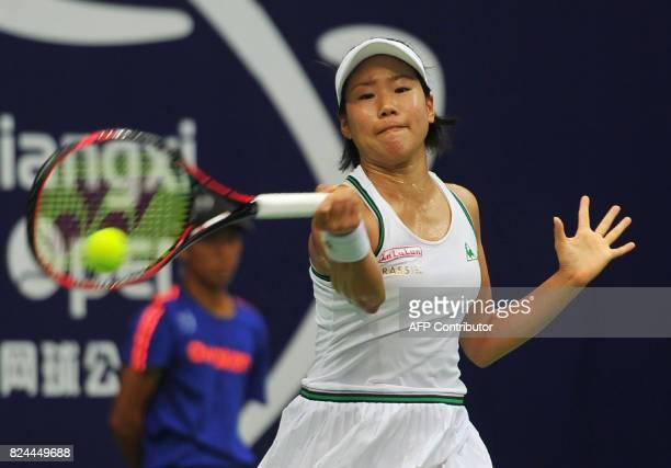 Japan's Nao Hibino hits a return to Peng Shuai of China in the women's singles final at the Jiangxi Open WTA tennis tournament in Nanchang in central...