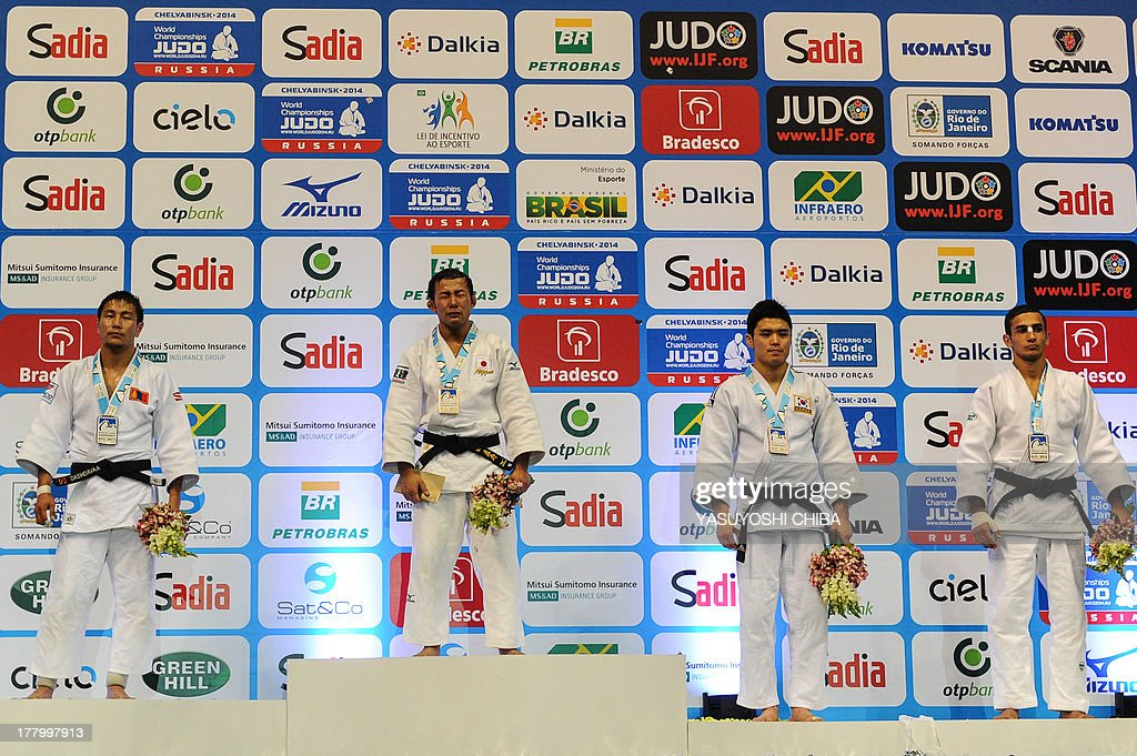 Japan's Naohisa Takato (2-L), Mongolia's Amartuvshin Dashdavaa (L) and Azerbaijan's Orkhan Safarov (R) and South Korea's Won Jin Kim, pose on the podium after obtaining the gold, silver and bronze medals respectively, in the men's 60kg category of the IJF World Judo Championship in Rio de Janeiro, Brazil, on August 26, 2013.