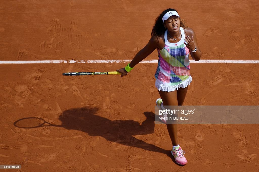 Japan's Naomi Osaka reacts during her women's third round match against Romania's Simona Halep at the Roland Garros 2016 French Tennis Open in Paris on May 27, 2016. / AFP / MARTIN