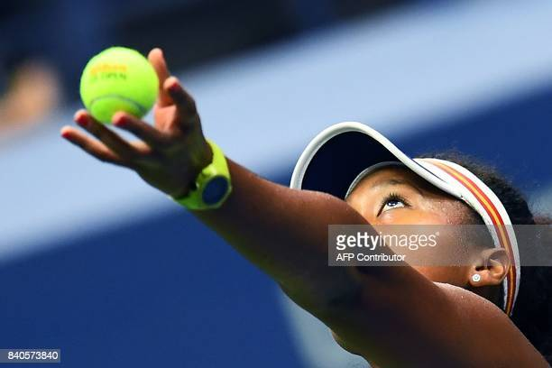 Japans Naomi Osaka serves the ball to Germanys Angelique Kerber during their 2017 US Open Women's Singles match at the USTA Billie Jean King National...
