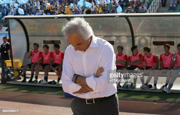 Japan's national football team head coach Vahid Halilhodzic reacts during the 2018 World Cup qualifying football match between Japan and Iraq at the...