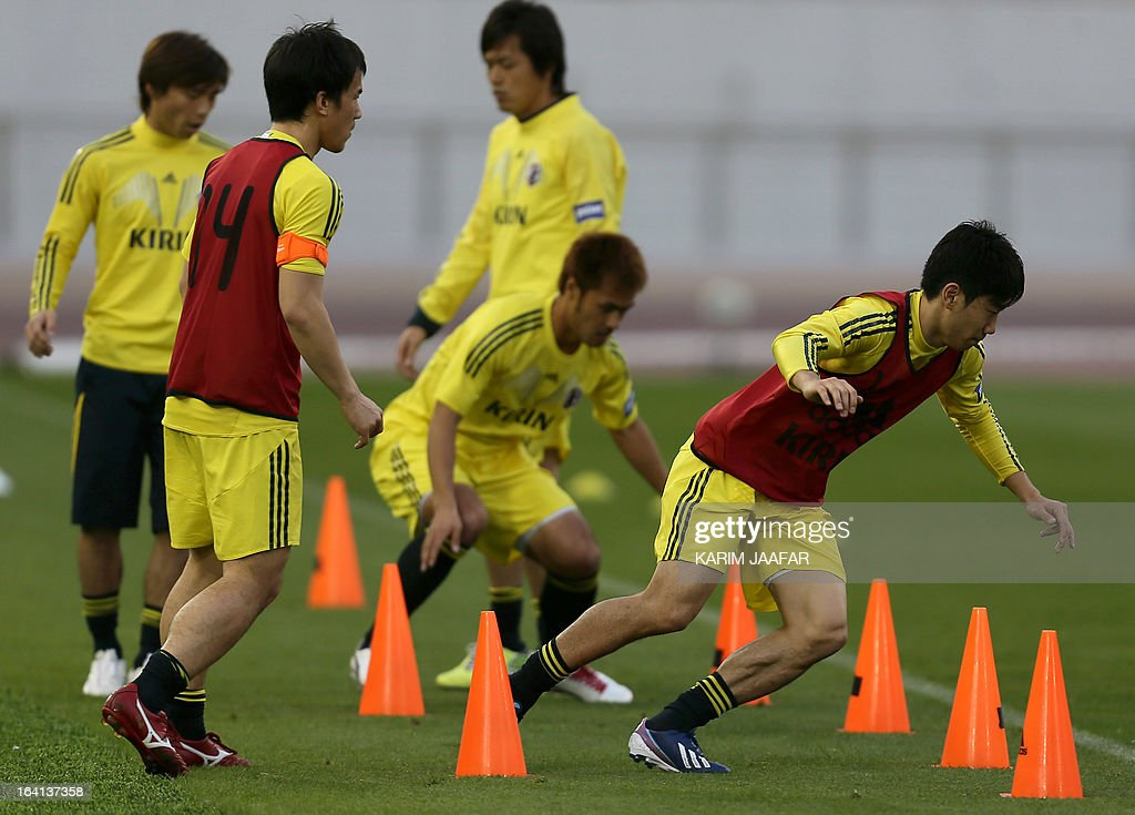 Japan's national soccer player Shinji Kagawa (R) takes part in a training session at the Khalifa Stadium in Doha on March 20, 2013. Japan will play a friendly soccer match against Canada on March 22 in Doha.