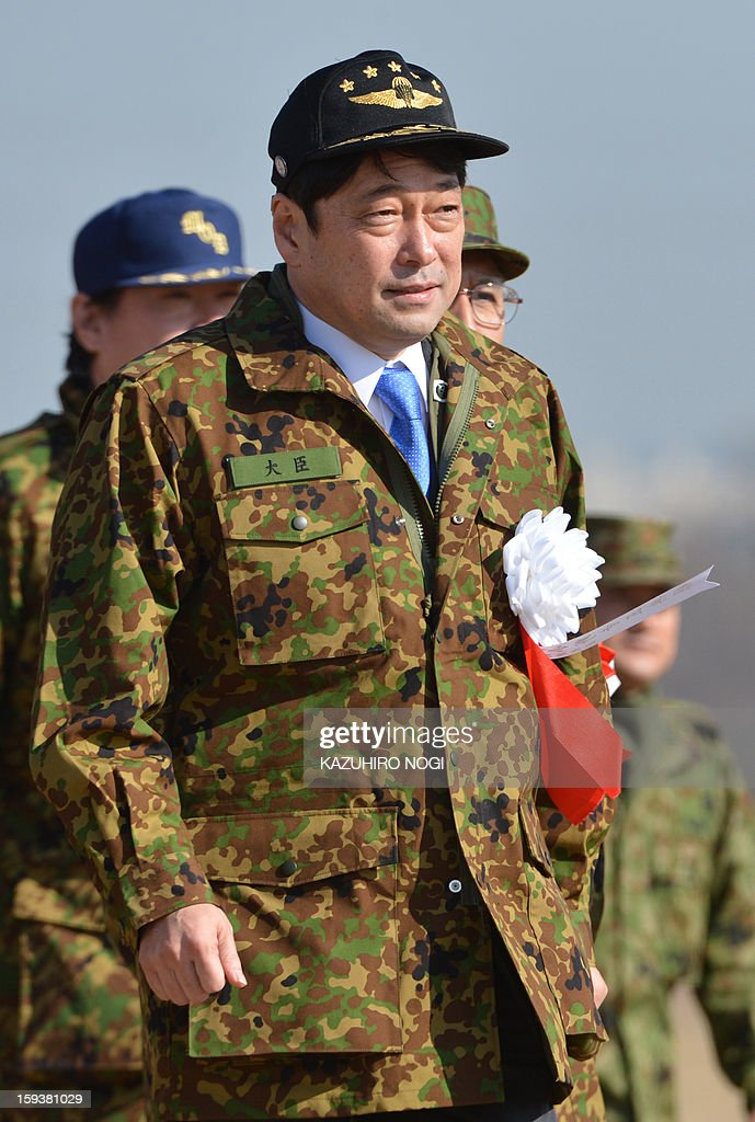 Japan's new Defense Minister Itsunori Onodera arrives at the Japan Self Defense Forces training ground to inspect troops as they parachute in during a new year drill in Narashino, suburban Tokyo on January 13, 2013. A total of 300 personnel, 20 aircraft and 33 vehicles took part in the open exercise at the defense force's Narashino training ground. AFP PHOTO / KAZUHIRO NOGI