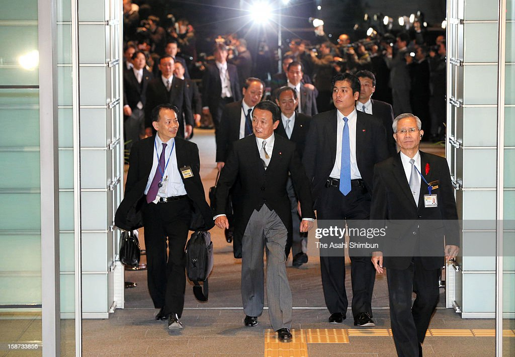 Japan's new deputy Prime Minister <a gi-track='captionPersonalityLinkClicked' href=/galleries/search?phrase=Taro+Aso&family=editorial&specificpeople=559212 ng-click='$event.stopPropagation()'>Taro Aso</a> leaves Prime Minister Shinzo Abe's official residence to attend the appointment ceremony on December 26, 2012 in Tokyo, Japan. Abe filled his Cabinet with economic policy veterans, who are also close colleagues, in hopes that resuscitating the Japanese economy will propel his party to victory in the Upper House election next summer.