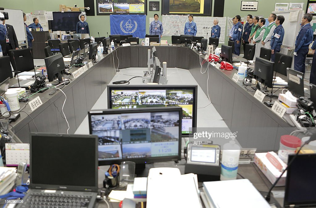 Japan's new Prime Minister Shinzo Abe addresses workers at the Tokyo Electric Power Company's (TEPCO) emergency operation center inside the crippled Fukushima Daiichi nuclear power plant in Ota on December 29, 2012. The clean-up at Fukushima after its tsunami-sparked nuclear meltdowns is an 'unprecedented challenge' Abe told workers during a tour of the plant. AFP PHOTO / Itsuo Inouye / POOL