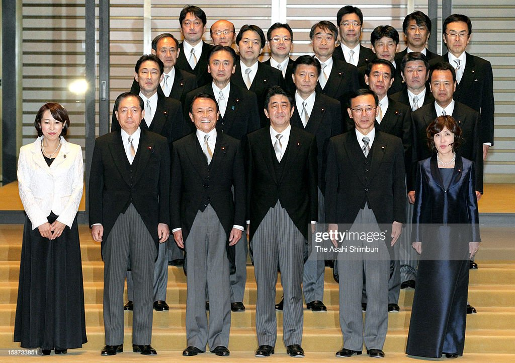 Japan's new Prime Minister <a gi-track='captionPersonalityLinkClicked' href=/galleries/search?phrase=Shinzo+Abe&family=editorial&specificpeople=559017 ng-click='$event.stopPropagation()'>Shinzo Abe</a> (front row, C) and his cabinet members pose for photogrpahs after the appointment ceremony at the Imperial Palace on December 26, 2012 in Tokyo, Japan. Abe filled his Cabinet with economic policy veterans, who are also close colleagues, in hopes that resuscitating the Japanese economy will propel his party to victory in the Upper House election next summer.