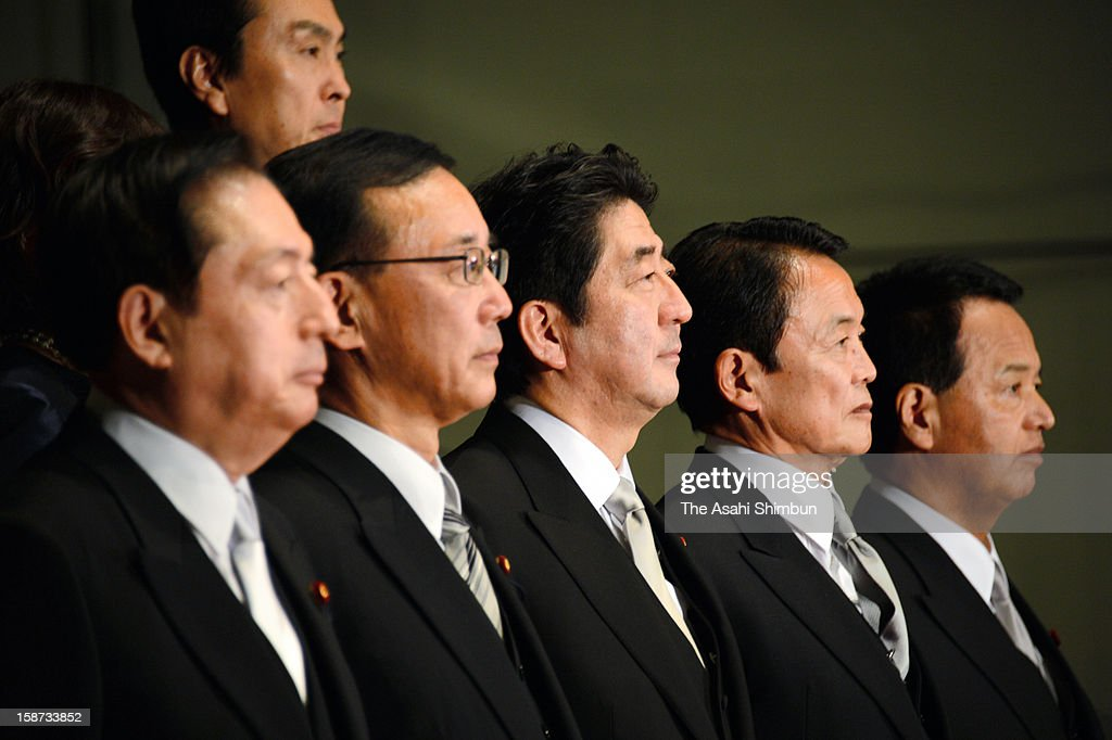 Japan's new Prime Minister <a gi-track='captionPersonalityLinkClicked' href=/galleries/search?phrase=Shinzo+Abe&family=editorial&specificpeople=559017 ng-click='$event.stopPropagation()'>Shinzo Abe</a> (front row, C) and his cabinet members pose for photographs at Abe's official residence on December 26, 2012 in Tokyo, Japan. Abe filled his Cabinet with economic policy veterans, who are also close colleagues, in hopes that resuscitating the Japanese economy will propel his party to victory in the Upper House election next summer.