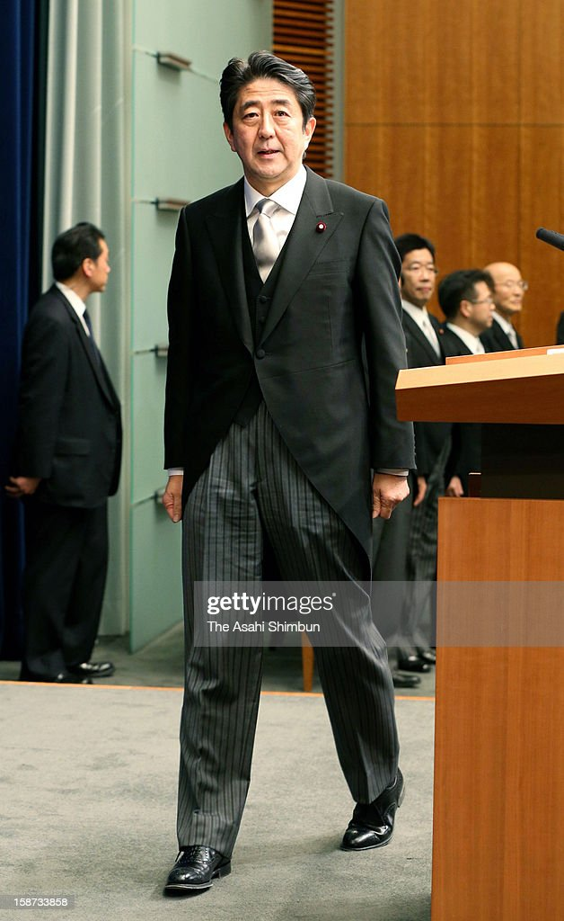 Japan's new Prime Minister <a gi-track='captionPersonalityLinkClicked' href=/galleries/search?phrase=Shinzo+Abe&family=editorial&specificpeople=559017 ng-click='$event.stopPropagation()'>Shinzo Abe</a> attends a press conference at Abe's official residence on December 26, 2012 in Tokyo, Japan. Abe filled his Cabinet with economic policy veterans, who are also close colleagues, in hopes that resuscitating the Japanese economy will propel his party to victory in the Upper House election next summer.