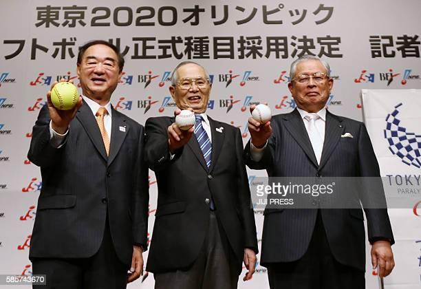 Japan's Nippon Professional Baseball commissioner Katsuhiko Kumazaki Baseball Federation of Japan President Norio Ichino and Japan's Softball...