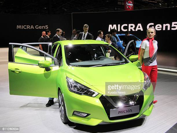 Japan's Nissan Motor Co unveils the fifth generation model of its Micra subcompact car at the Paris Auto Show on Sept 29 the first press day of the...