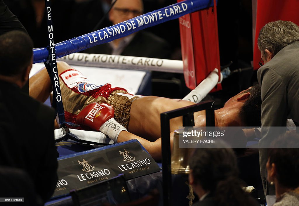 Japan's Nobuhiro Ishida lies on the canvas after being knocked out by Gennady Golovkin of Kazakhtan during their middleweight WBA boxing match, on March 30, 2013 in Monaco.