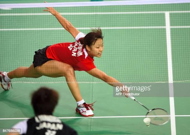 Japan's Nozomi Okuhara returns a shot against Japan's Akane Yamaguchi during their women's singles semifinal match at the Korea Open Badminton...