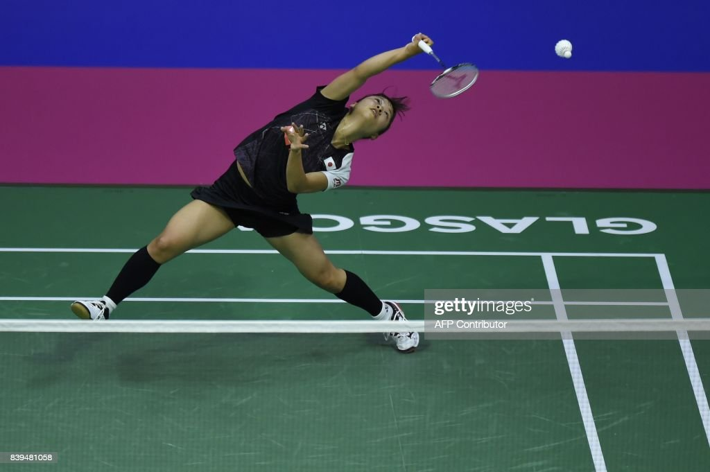 TOPSHOT - Japan's Nozomi Okuhara returns against India's Saina Nehwal during their semi-final women's singles match during the 2017 BWF World Championships of badminton at Emirates Arena in Glasgow on August 26, 2017. /