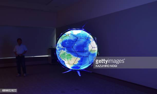 TOPSHOT Japan's NTT DOCOMO demonstrates a spherical drone display an unmanned aerial vehicle that displays LED images on an omnidirectional spherical...