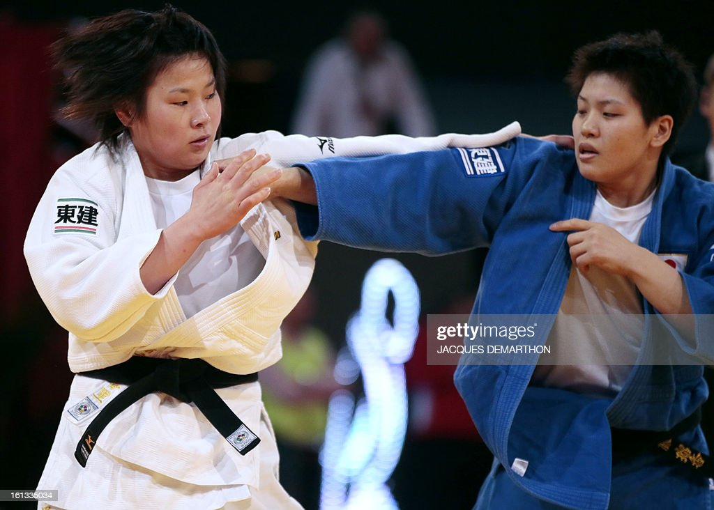 Japan's Ogata Akari (white) fights against Japan's Sato Ruika (blue) on February 10, 2013 in Paris, during the eliminatories of the Women -78kg of the Paris Judo Grand Slam tournament.