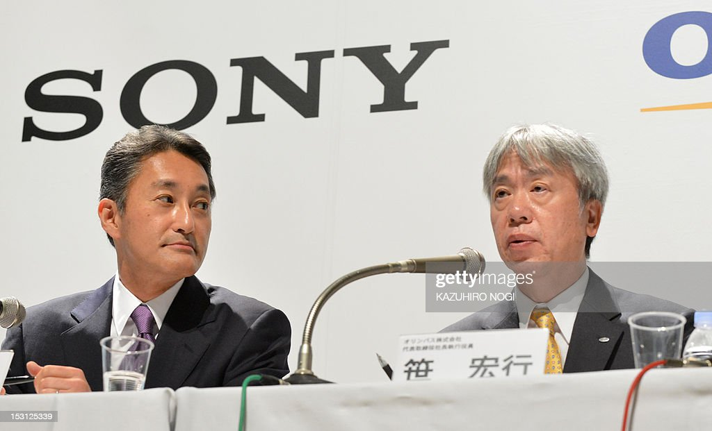Japan's Olympus Corporation President Hiroyuki Sasa (R) speaks while Sony Corporation President Kazuo Hirai (L) looks on during their joint press conference in Tokyo on October 1, 2012. Olympus and Sony announced that the two companies have entered into a business alliance agreement and a capital alliance agreement through a third-party allotment of Olympus's common shares to Sony.