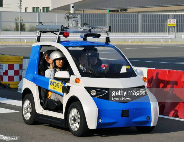 Japan's Panasonic Corp unveils a twoseat prototype car equipped with an autonomous driving system in Yokohama south of Tokyo on Oct 10 2017 Panasonic...