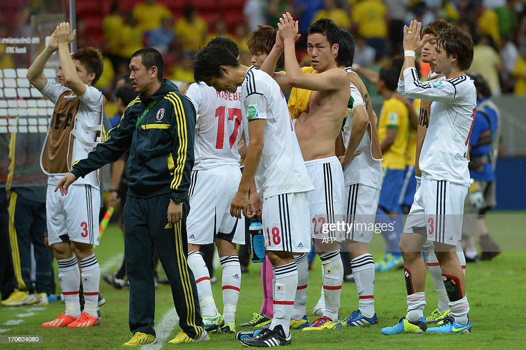 Japan's players acknowledge the crowd after losing 3-0 to Brazil in their FIFA Confederations Cup Brazil 2013 Group A football match, at the National Stadium in Brasilia on June 15, 2013.