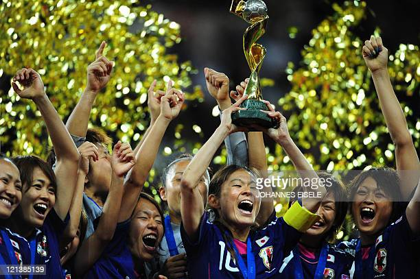 Japan's players celebrate with the trophy after the FIFA Women's Football World Cup final match Japan vs USA on July 17 2011 in Frankfurt am Main...