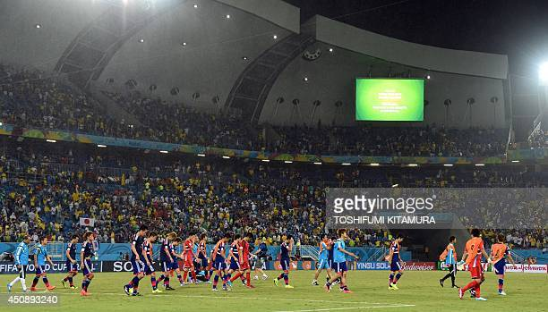 Japan's players react after a Group C football match between Japan and Greece at the Dunas Arena in Natal during the 2014 FIFA World Cup on June 19...