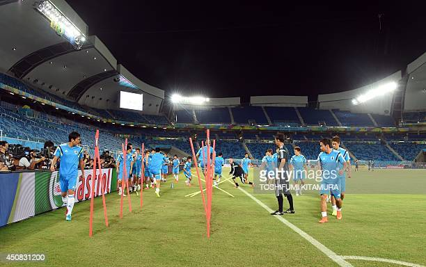 Japan's players work out during a team training session at the Dunas Arena in Natal on June 18 one day before their second match against Greece AFP...