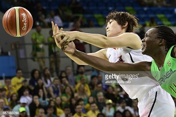 TOPSHOT Japan's power forward Maki Takada and Brazil's power forward Clarissa Santos chase the ball during a Women's round Group A basketball match...