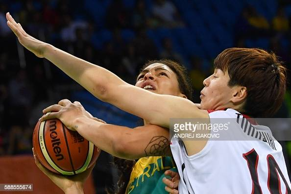 TOPSHOT Japan's power forward Ramu Tokashiki defends against Australia's centre Elizabeth Cambage during a Women's round Group A basketball match...