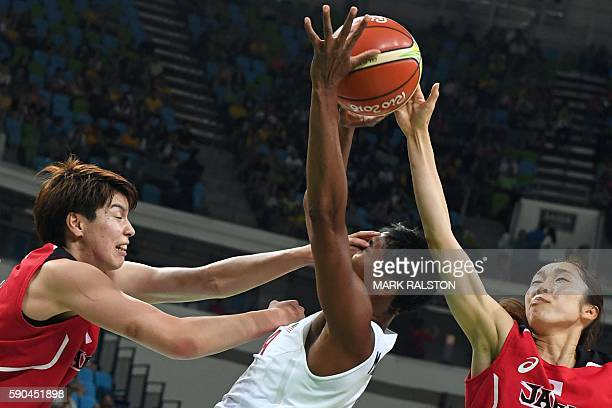 TOPSHOT Japan's power forward Ramu Tokashiki defends against USA's small forward Angel Mccoughtry during a Women's quarterfinal basketball match...