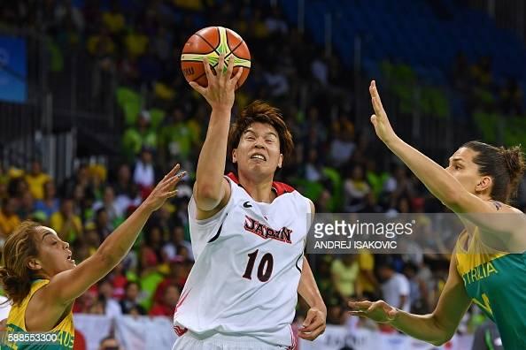 TOPSHOT Japan's power forward Ramu Tokashiki goes to the basket between Australia's point guard Leilani Mitchell and Australia's centre Marianna Tolo...